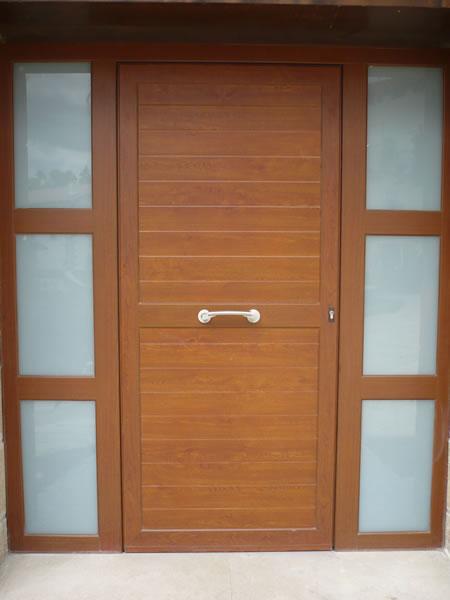 Trabajos realizados puertas de aluminio y pvc navarra for Puertas de calle de pvc